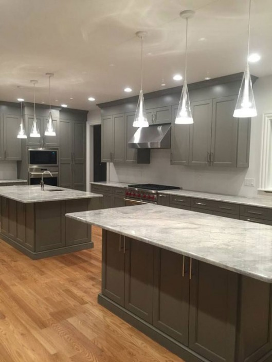 Contemporary gray kitchen with island and range hood