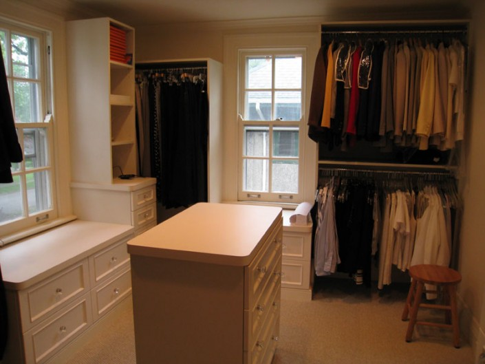 Contemporary white closet with island