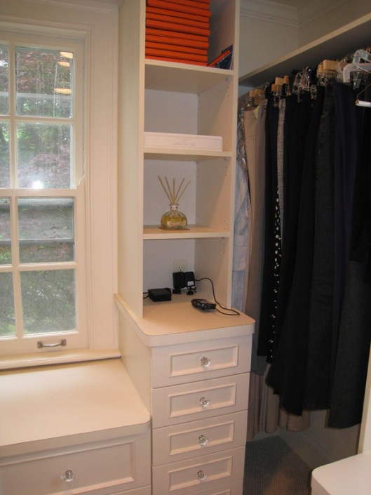 Contemporary white closet with island drawer