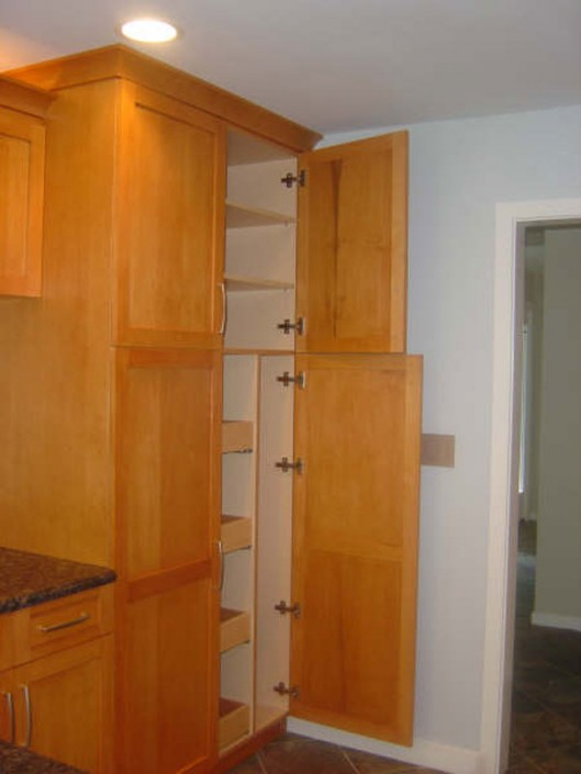 A Traditional stained kitchen cabinets