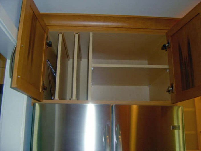 Traditional stained kitchen vertical shelf
