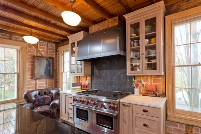Traditional natural kitchen with range hood