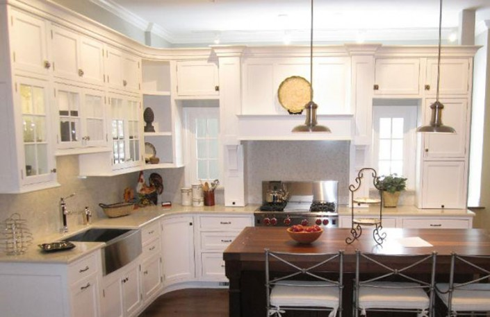Contemporary white kitchen with range hood and island